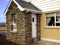 New stone fronted extension & balcony by Pat Harkin Stonework & Restorations, Donegal, Ireland