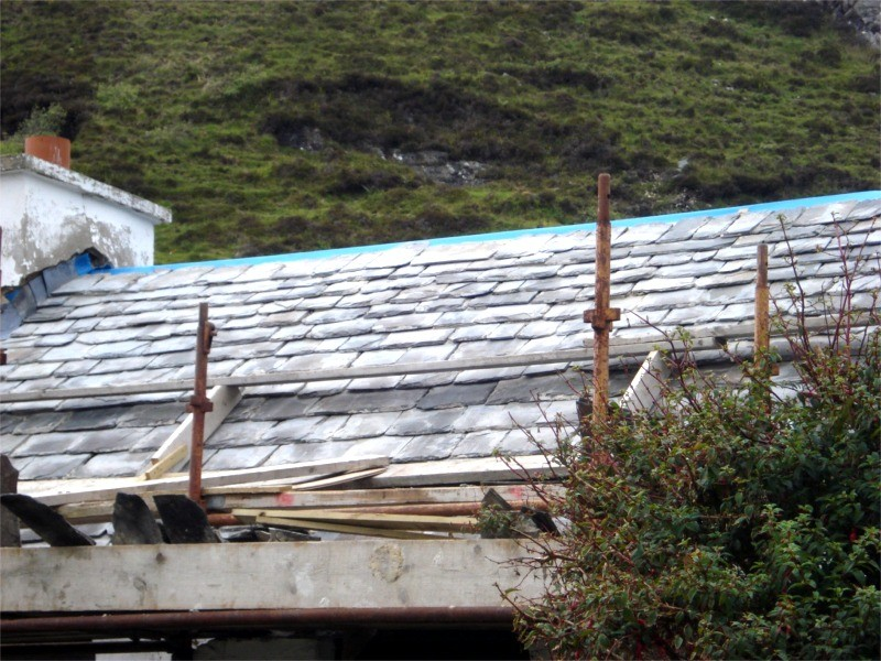Roisin Slate roof undergoing restoration by Pat Harkin Stonework & Restorations, Donegal, Ireland